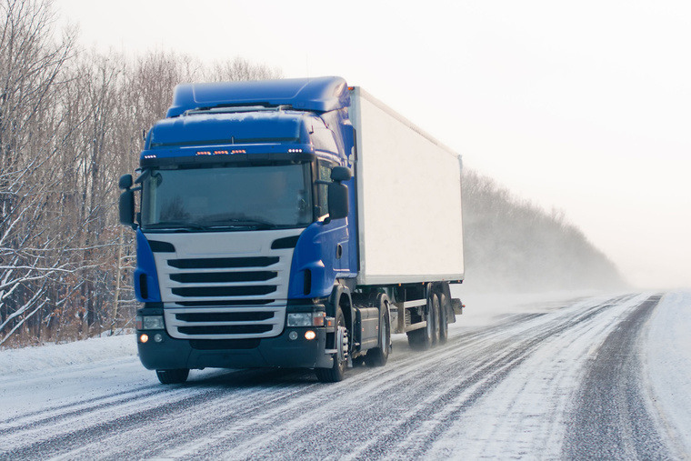 background truck on a snowy road tyre