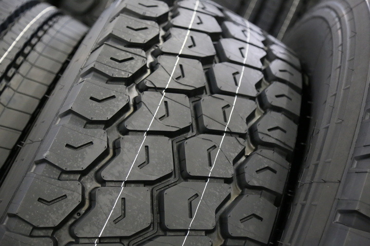 background new truck tyre at factory help and advice