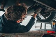 man fixing vehicle engine 2244746